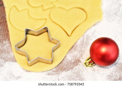 Christmas cookies dough and cookie cutter