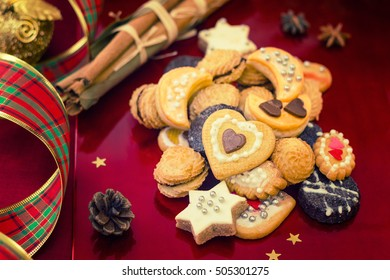 Christmas cookies with festive decoration on red background