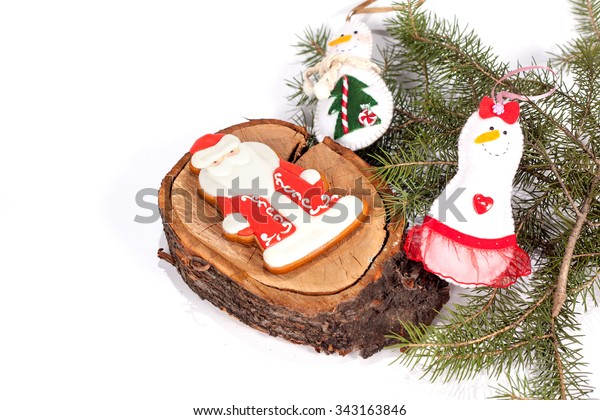 Christmas cookies with festive decoration on the white background.