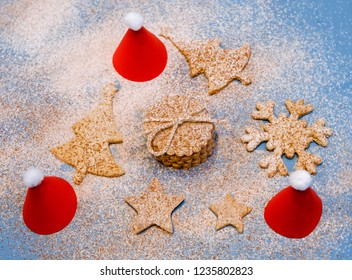e045b639ebd94 Christmas cookies with flour and cocoa topping and three paper Santa s hats