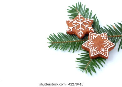 Christmas cookies (gingerbread) on green branch