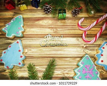christmas cookies and gingerbread traditional food on wooden board fir branches