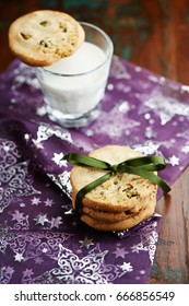 Christmas cookies with a glass of milk - Shutterstock ID 666856549