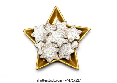 christmas cookies in a golden star white background