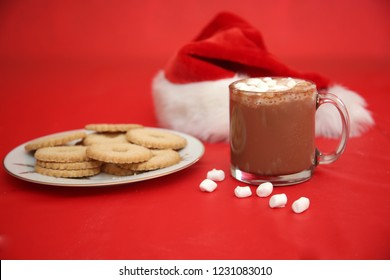 Christmas Cookies and Hot Chocolate on a Red Background. Hot Coco and Cookies. Christmas Food.