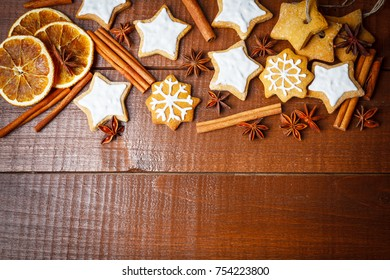 Christmas cookies with icing and spices on wooden. Homemade Christmas cookies photo