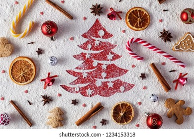 Christmas cookies, ingredients and decorations background with xmas tree drawing in flour