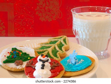 Christmas Cookies and Milk - A plate of decorated holiday cookies and a glass of milk against a cheerful happy holidays background.
