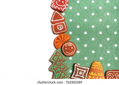 Christmas cookies on white and green background.
