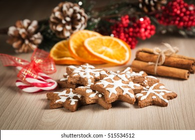 Christmas cookies on a wooden surface with the background decor