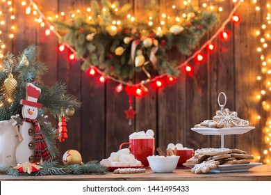 Christmas cookies on wooden table in kitchen
