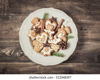 Christmas cookies in a plate on a wooden table