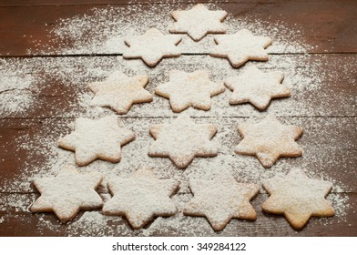 Christmas cookies in the shape of star with flour and butter, italy