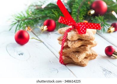 Christmas cookies in the shape of a star tied with red ribbon
