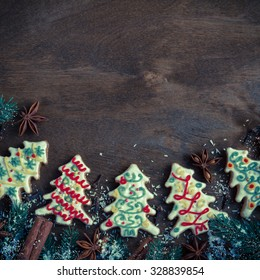 Christmas cookies in the shape of a Christmas tree on a dark wooden background. Retro style