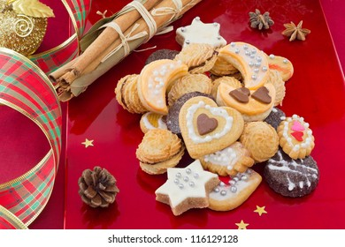 Christmas cookies, short bread in different shapes, with spices, festive red background