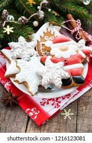 Christmas cookies and Christmas tree on a old wooden background