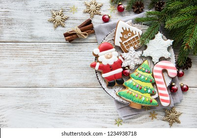 Christmas cookies and Christmas tree on a old wooden table