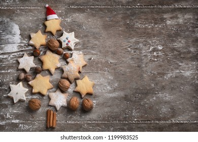 Christmas cookies tree on rustic wooden background. Top view with copy space