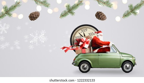 Christmas countdown arriving. Santa Claus on car delivering New Year gifts and clock at gray background