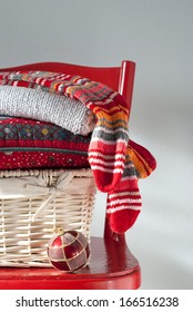 Christmas Country Gifts with Striped Golfs on a red chair