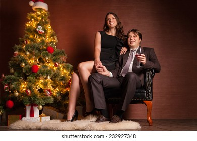 Christmas Couple. Happy Smiling Family at home celebrating New Year