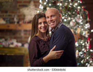 Christmas couple portrait in front of tree