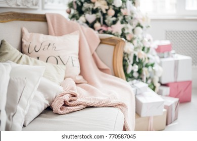 christmas coziness christmas tree, pillows on a couch feather pink veil blanket of thick yarn, Christmas cosiness