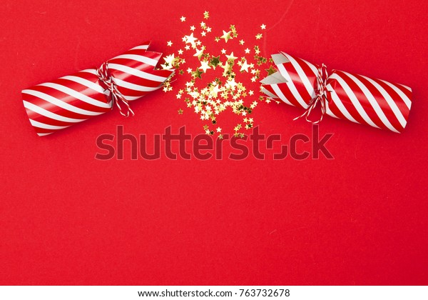 Christmas crackers on a red background