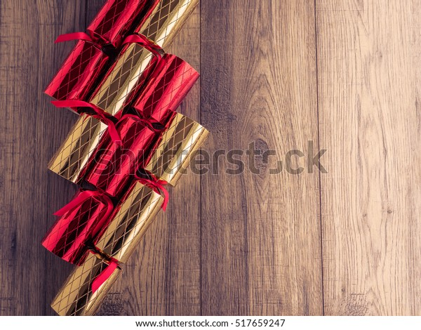 Christmas crackers on wood board background