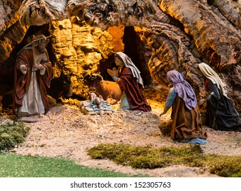 Christmas creche with women worshiping god