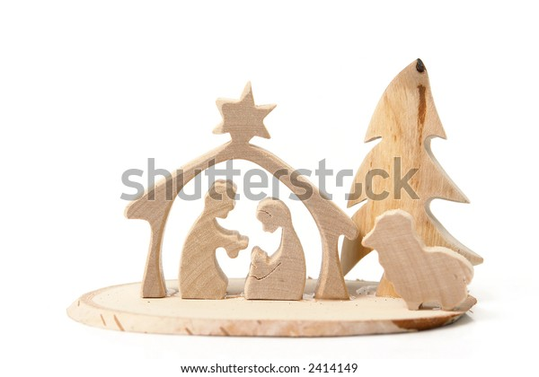 Christmas crib cut out from plywood over white background