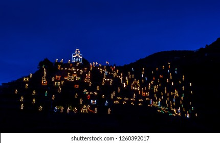 The Christmas Crib (presepe) of Manarola, Cinque Terre, Liguria, Italy, lit at night, a traditional religious scene made up of thousands of light bulbs on the hill of Manarola