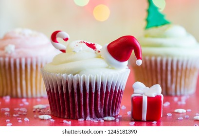 Christmas cupcake and holiday ornament on colorful defocused background