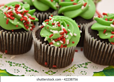 Christmas cupcakes of red white and green, ready for a celebration.  Shallow depth of field.