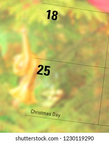 Christmas date marked on calendar blended with blurred photo of ornament hanging on tree