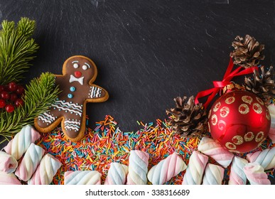 Christmas Day invitation card with sweets on black slate
