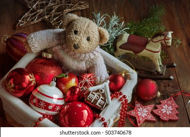 Christmas decor balls with bear toy in the wooden box. Selective focus