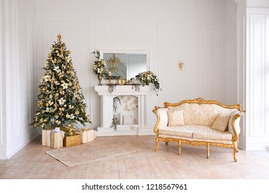Christmas decor in studio of a classic style living room with a vintage armchair, fireplace, Christmas tree. New Year's interior