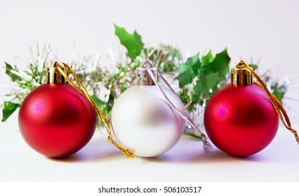 Christmas decor: Three bright baubles, two red and one silver