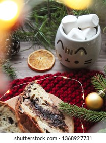 Christmas decor with traditional panettone, cup of hot chocolate with marshmallows, orange slice, christmas tree. Merry Christmas