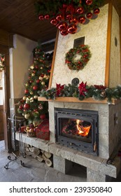 Christmas decorated burning fireplace in a restaurant