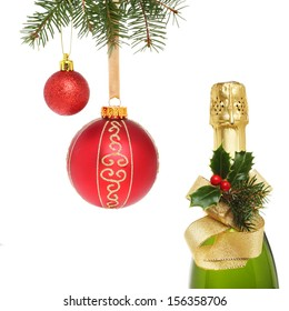 Christmas decorated champagne bottle and red baubles isolated against white
