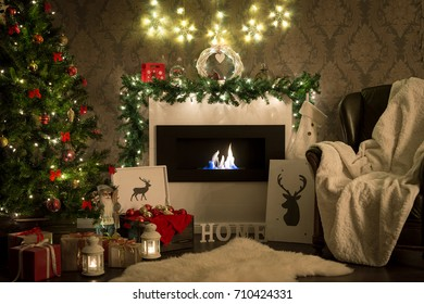 Christmas. Decorated room with fireplace and christmas tree