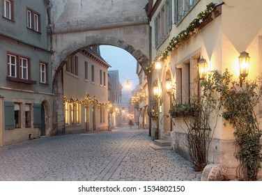 Christmas decorated street in Rothenburg ob der Tauber at winter morning, Bavaria, Germany.