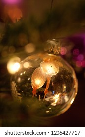 christmas decoration background with christmas ball made of glass and wax drops upon it