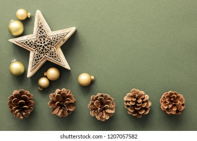 A Christmas decoration background with pine cones and a star