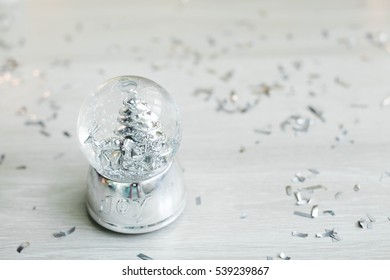 Christmas decoration ball with snow inside. New Year's gift