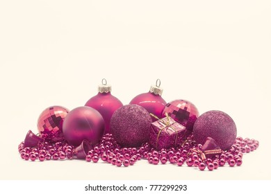 Christmas decoration, balls, beads, bell close up isolated.
