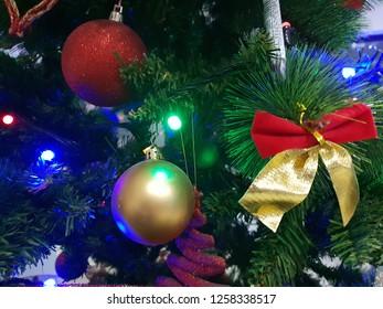 christmas decoration balls and a ribbon